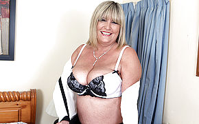 Thick Breasted British Mature Dame Playing With Her Toy