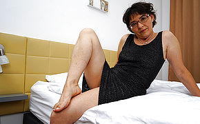 Wooly Mature Doll Wanking On Her Bed