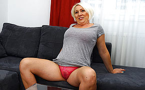 Mischievous Mature Tart Playing On Her Couch