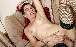 British Housewife Undresses And Plays With Her Shaved Pussy