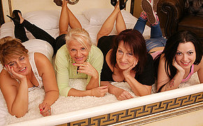 Group Of Mature And Nubile Lesbians Pummeling On Couch