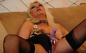 Ash-blonde Cougar Rogue Teases Her Labia