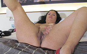 Victorious Cougar Gal Stroking On Her Sofa With A Plaything