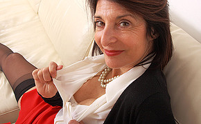 Brown-haired Milf In Dark-hued Bitchy Stockings Is Showcasing Her White Lingerie
