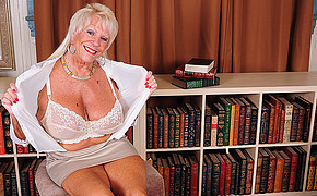 Buxomy Mummy Sitting Next To The Bookcase Is Showing Her Great Underwear