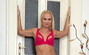Mind-blowing Platinum-blonde In Red Underwear Is Standing Next To The Magnificent Doors