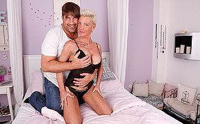 Sensuous Blond Wearing Dark-hued Lingerie Is Getting Massaged By Her Boyfriend